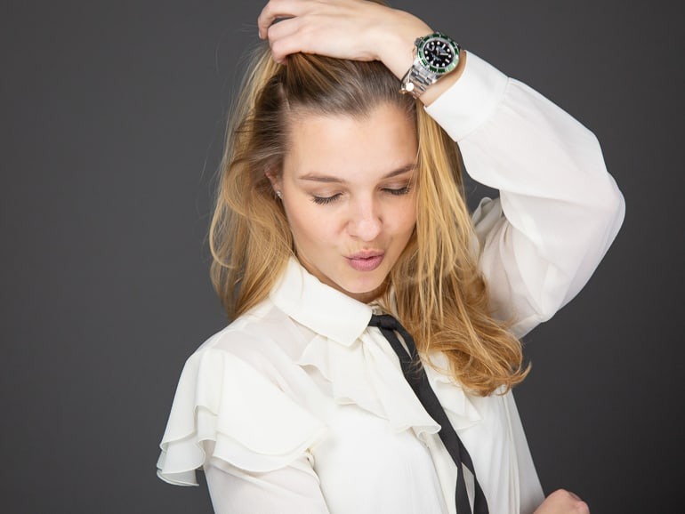 Portrait photography of a posing blonde woman with a white blouse